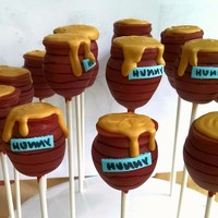Classic Pooh Hunny Pot Cake Pops Excited at how these turned out! I first shaped the bottom of the pot in cake pop dough and attached to the stick, then dipped it in terra...