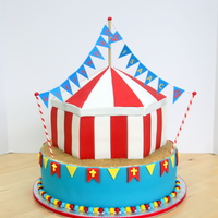 Circus/carnival Birthday/baptism Cake The top of the tent is made from rice krispie treats. The border is Sixlets. My first outing with candy clay - LOVE IT!