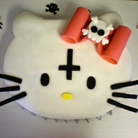 Alternative Hello Kitty Two layers of red velvet cake with white chocolate buttercream in between. All decor is made from colored fondant.