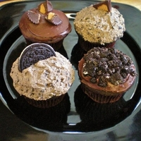 Cupcakes Dark chocolate fudge cupcakes with oreo peanut butter buttercream and basic chocolate frosting.