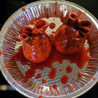 "Bleeding Hearts Strawberry cake covered with red fondant and a strawberry sauce poured over top as ""blood"""