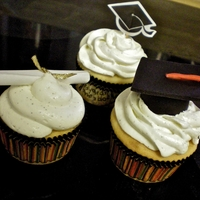 "Graduation Cupcakes Vanilla cupcakes with vanilla bean buttercream. ""Diploma"" made from parchment paper with wired ribbon tied around, and ""..."