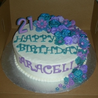 Teal And Purple Flowers Birthday Cake She was very specific that she did NOT want her cake covered in fondant...Buttercream ONLY;-)