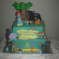 Disney's Brave Themed Cake The mommy wanted to make sure there was actual toys on the cake for the birthday girl to keep for later. She provided the toys to me that...