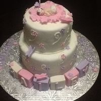 Girly Baptism Cake. Vanilla cake covered in homemade fondant, gumpaste letter blocks and first impressions baby!