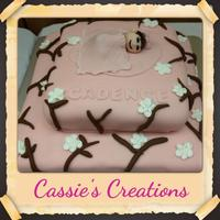 Cherry Blossom Baby Shower Cake  Cherry Blossom inspired baby shower cake. 2 tiered white cake with pink and brown fondant and white icing cherry blossoms. The baby on top...