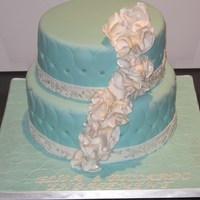 Turquoise And White Ruffled Flowers TURQUOISE FONDANT, WHITE RUFFLED FLOWERS, SILVER BEADING