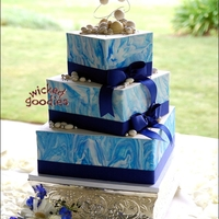 Blue Marble Wedding Cake Square wedding cake with offset tiers, blue marbled modeling chocolate wrap, and real ribbon.