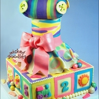 Baby Shower Tower Towering baby shower cake decorated with modeling chocolate and molded chocolates. Includes booties, striped baby pillow, buttons, baby...
