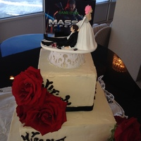Game Over.... The Groom had this Mass Effect cake topper custommade with his Brides fuscia hair....