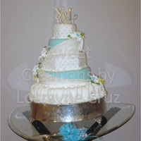 Blue Diamond Wedding Cake This cake was done for my cousins wedding about 2 years ago. First time I made a fondant skirt.