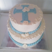Baptism Cake Bottom Tier: Strawberry Buttermilk Cake, Top Tier: Triple Chocolate Fudge, with Vanilla Buttercream and buttercream accents.