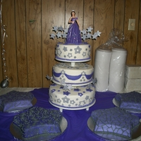 Stars And Purple Quince Cake Vanilla Cake with Vanilla Buttercream. Fondant covered tiers and star accents.