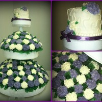 "Cupcake Bouquet Wedding Cake It Has 150 Cupcakes With A 6 Inch Cake On Top For The Bride Amp Groom To Cut It Measured 26 Around At The cupcake bouquet wedding cake. It has 150 cupcakes with a 6 inch cake on top for the bride & groom to cut. It measured 26"" around..."