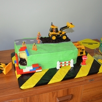 Construction Cake Buttercream cover (not my favourite medium). (Road is fondant, dirt/mud is choc cake, construction signs tools etc are plastic toys........