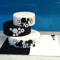 Black And White My first tiered cake. Top two tiers are styrofoam.