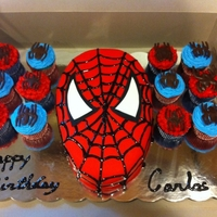 Spider Man Cake And Cupcakes White cake w/ buttercream icing and vanilla fondant. I used a black gel to make the lines on the mask. The cupcakes are chocolate with...