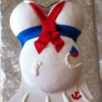 Sailor Dress Prego Baby Shower Cake White cake w/ buttercream icing and vanilla fondant.