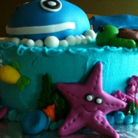 Under The Sea Cake Vanilla cake covered in buttercream icing with fondant decorations