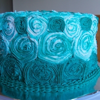 1346203554.jpg Striped teal buttercream rosettes