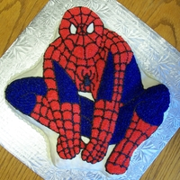 Spiderman Cake White cake covered in buttercream. Used tip 14 to cover the cake with blue and red stars.