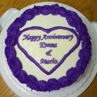Anniversary My 4th cake.... Triple layer chocolate with chopped Skor bars sprinkled on chocolate buttercream icing. Finished with purple rosettes. The...