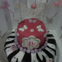 Girls Birthday Cake Zebra Stripes with pink top,glittter,flowers and butterflies.