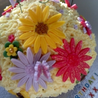 Giant Cup Cake Flower Pot Giant cup cake with milk chocolate bottom butter cream topping with giant flowers