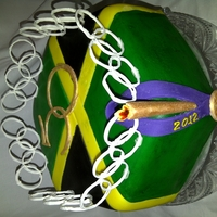 Jamaican Flag Independence Olympics Cake Jamaican black / fruit cake covered in fondant to represent the Jamaican flag. Surrounded by Olympic rings, features the 50 to symbolize...