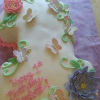 I Made This Number One Cake For My Neices First Birthday I Made The Flowers And Butterflies With Gumpaste And It Is Covered With Mmf It W  I made this number one cake for my neice's first birthday. I made the flowers and butterflies with gumpaste and it is covered with mmf...