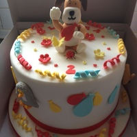 Kipper The Dog Chocolate cake with chocolate and vanilla buttercream. Handmade cake topper and decorations to match.