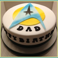 Star Trek This was made for our Dad, he's a big Star Trek fan :) The logo was handmade and airbrushed. The cake itself is chocolate with...