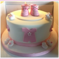 Pink Booties This customer requested this cake for her sisters baby shower, she asked me to use the booties that she had on her own daughter's...