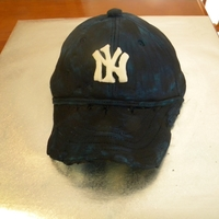 Yankees Cap   My first attempt at using fondant !!! Wasn't a very pretty outcome, but I got the result I wanted...a happy son :)