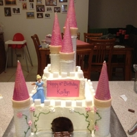 Disney Princess Castle Cake  Buttercream covered white chocolate mud cake with sugar cube detail. Ice cream cone turrets dipped in candy melts and dusted with fairy...