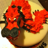 Dragon Cake   White fondant with an orange Royal Icing Dragon