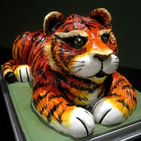 Rawr 3D Tiger Cake. Free-hand carved chocolate fudge cake. Hand painted with food colouring. This bad kitty measures in at 60cm x 40cm. It...