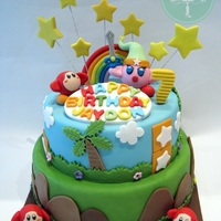 Kirby's Adventures 2 Tier Kirby cake with handmade figurines