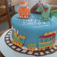 Dinosaur Train Chocolate cake with banana buttercream frosting and fresh banana filling as well as marshmallow fondant finish