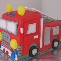 Firetruck Birthday Cake Buttercream with fondant accents.