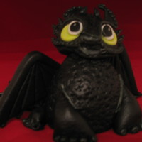 "Dragon Figurine My version of ""Toothless""Hand-sculpted, not 100% accurate, but close enough."