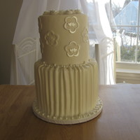 Classic Ivory Wedding cake done in fondant.