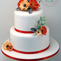White Wedding Cake With Colorful Flowers