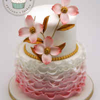 Pink Dogwood Ruffle Cake   Two tier wedding cake with dogwood in abstract color version