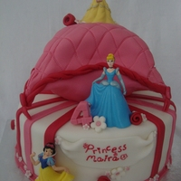 Two Tier Disney Princess Cushion Cake A two tier Disney princess birthday girl cushion cake