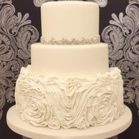 Ruffle Roses Wedding Cake Ruffle Rosses Weddign Cake in Crisp clean White with Silver & White Pearls
