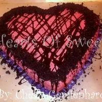 Valentine's Cake/cake Pops/chocolate Covered Goodies Yellow Cake, Oreo Buttercream inside and out. Hershey's Syrup Drizzeled on top of cake. Crushed Oreo's edged on top of cake. Can...