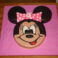Minnie Mouse Cake Love this cake! Covered in fondant with buttercream outlining.