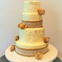 Wedding Cake For Nephew   Buttercream with burlap decorations.