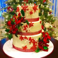 Christmas Wedding Cake Buttercream chocolate and vanilla cake, with fondant decorations